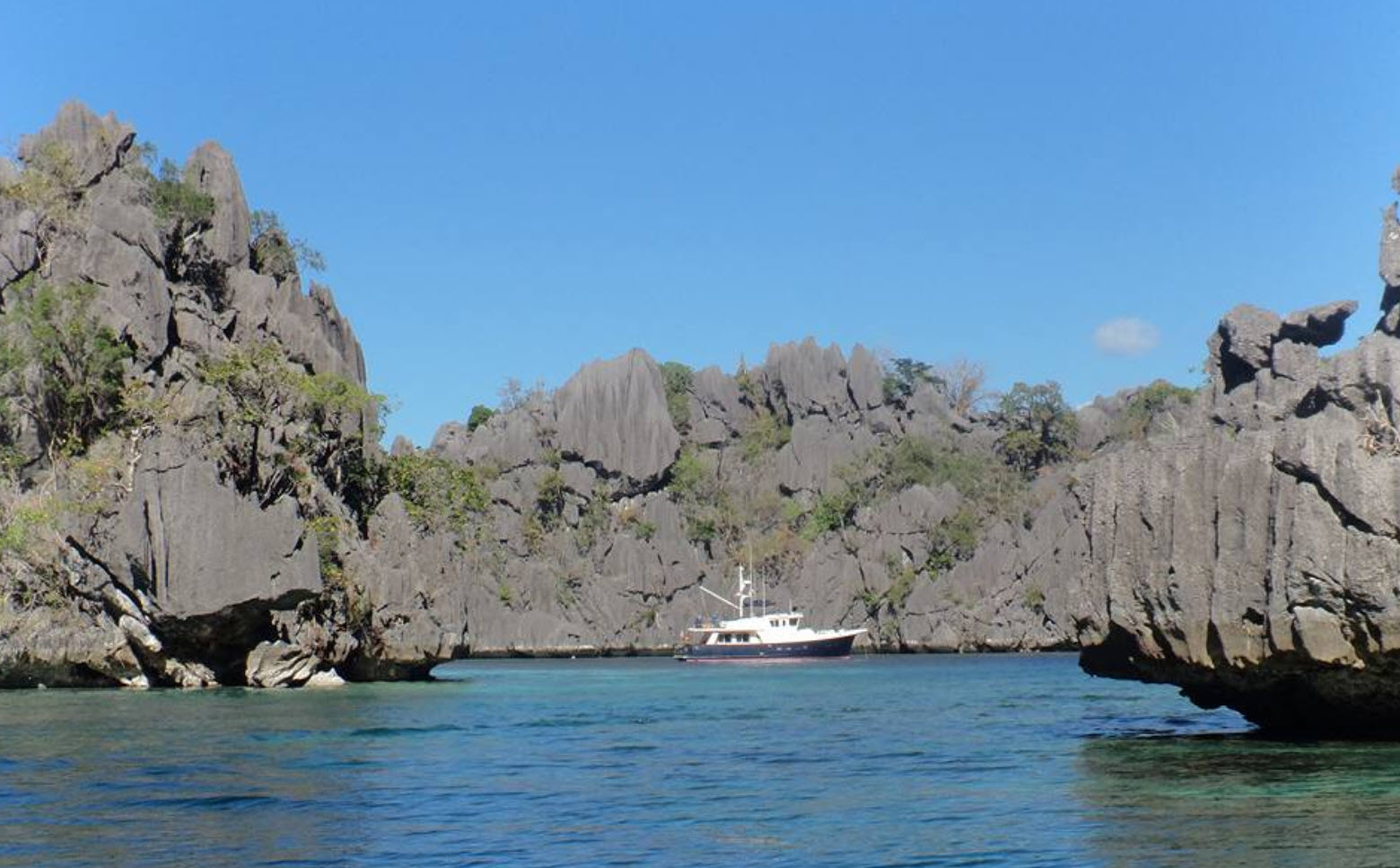 yacht anchored in a secluded bay philippines